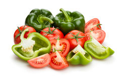 Green bell pepper and tomato Stock Images