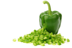 Green Bell Pepper With Cut Pieces Coming Out Royalty Free Stock Photography