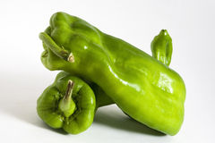 Green bell peppers. Ripe green bell peppers, isolated on white background Royalty Free Stock Photography