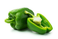 Green bell peppers. With water droplets on white background Royalty Free Stock Photography