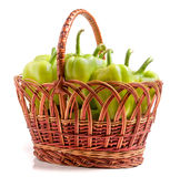 Green bell peppers in a wicker basket isolated on white background Royalty Free Stock Image