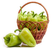 Green bell peppers in a wicker basket isolated on white background.  Stock Photography