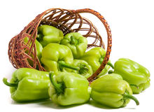 Green bell peppers in a wicker basket  on white background.  Stock Photography