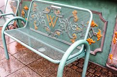 Green bench in front of elegant baroque pattern Royalty Free Stock Photo