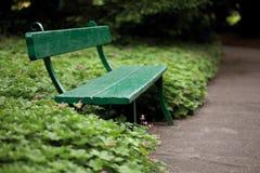 Green bench in garden Royalty Free Stock Photo