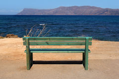 Green bench overlooking the sea Royalty Free Stock Photos