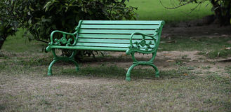Green Bench in Park Stock Photography
