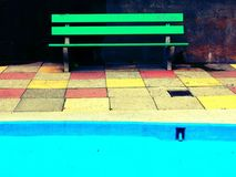 Green Bench and Pool Stock Photography