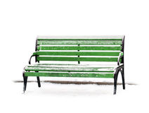 Green bench with show on white background Stock Photos
