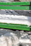 Green bench under snow Royalty Free Stock Photos