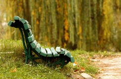 Green bench in woods Stock Photos
