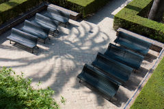 Green benches. Royalty Free Stock Photo