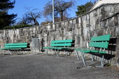 Green Outdoor Benches during a Sunny Day in Switzerland. Green benches made of wood and concrete photographed on a sunny spring day in Nyon, Switzerland. In this royalty free stock photography