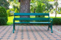 Wooden bench in the park stock images