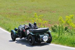 A green Bentley 4.5 Litre Le Mans takes part to the 1000 Miglia classic car race Stock Images