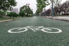 Green bicycle lane for biking. Beside the walkway in the city royalty free stock images