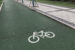 Green bicycle lane for biking. Beside the walkway in the city stock image