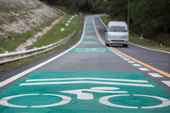 Green bicycle lanes on the asphalt road Stock Images