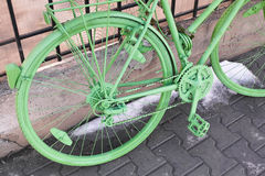 Green bicycle parked Stock Photography