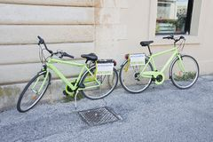 Green bicycle for rent Stock Images