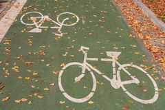 Green bicycle track. With white sign Royalty Free Stock Photography