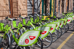 Green bicycles at a docking station for hire in Budapest. BUDAPEST, HUNGARY - FEBRUARY 22, 2016: Green bicycles at a docking station for hire in Budapest Stock Photography