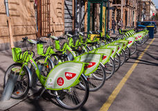 Green bicycles at a docking station for hire in Budapest. BUDAPEST, HUNGARY - FEBRUARY 22, 2016: Green bicycles at a docking station for hire in Budapest Royalty Free Stock Photography