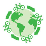 Green bicycles drive around the globe Royalty Free Stock Photography