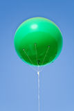 Green big balloon. Over blue sky Stock Photo