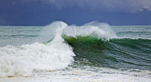Green big wave. A big green wave at stormy day Stock Image
