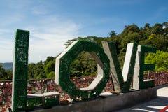 Green big word love outdoor, horizontal Royalty Free Stock Photography