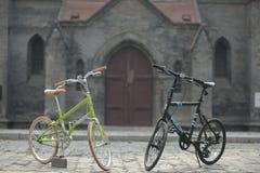 Green Bike Beside Black Bike Stock Photography
