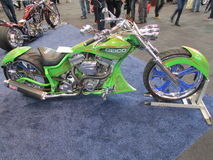 Green bike of insurance company Geico. 2015 New York International Auto Show. Stock Image