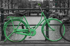 Green bike. Isolated on black and white over an Amsterdam Stock Photos