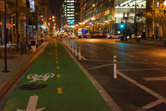 Green bike lane at night. Bike lane in Chicago at night with perspective view of roadway Stock Images