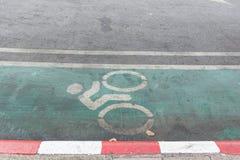 Green bike lane. Bike lane sign at side of road in Bangkok, Thailand Stock Images
