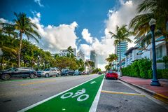 Green bike lane in world famous Miami Beach. Southern Florida, USA, bicycle, cyclist, sustainable, collins, avenue, keys, duval, street, abstract, america royalty free stock images