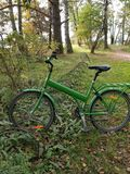 Green Bike Resting in Finnish Forest Stock Photography