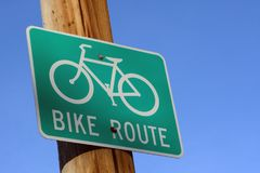 Bike route street sign. Green bike route street sign against blue sky Royalty Free Stock Images