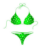 Green bikini suit with white dots Royalty Free Stock Photography