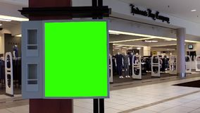 Green billboard for your ad in front of The Bay store stock video