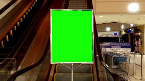 Green billboard for your ad inside Coquitlam Center shopping mall Stock Image