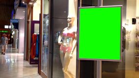 Green billboard for your ad inside Coquitlam shopping mall stock video
