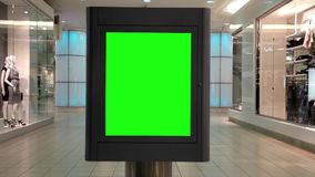 Green billboard for your ad inside Metropolis stock video
