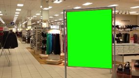 Green billboard for your ad inside Sears store. Stock Photo
