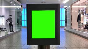 Green billboard for your ad inside the shopping mall stock video footage