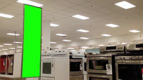 Green billboard for your ad beside large appliance stock video