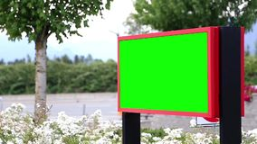 Green billboard for your ad with traffic flow background stock video footage