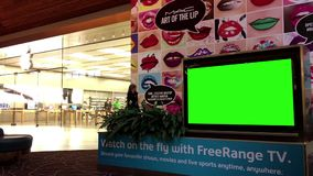 Green billboard for your ad at tv beside apple store stock video