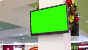 Green billboard for your ad at tv inside food court. At Coquitlam Center shopping mall stock video footage